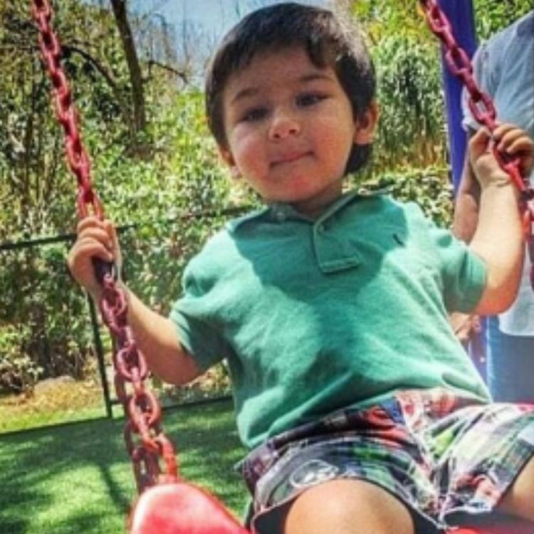 Taimur Ali Khan is a bundle of joy as he enjoys a swing ride in THIS throwback picture
