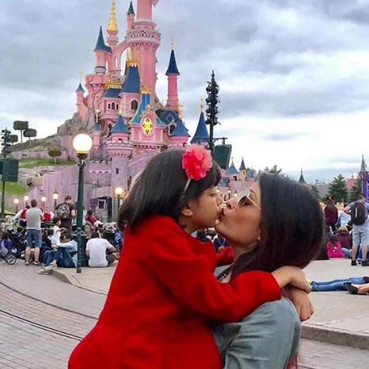 Throwback: Aishwarya Rai Bachchan, Aaradhya sharing a kiss at Disneyland is all about mother and daughter love