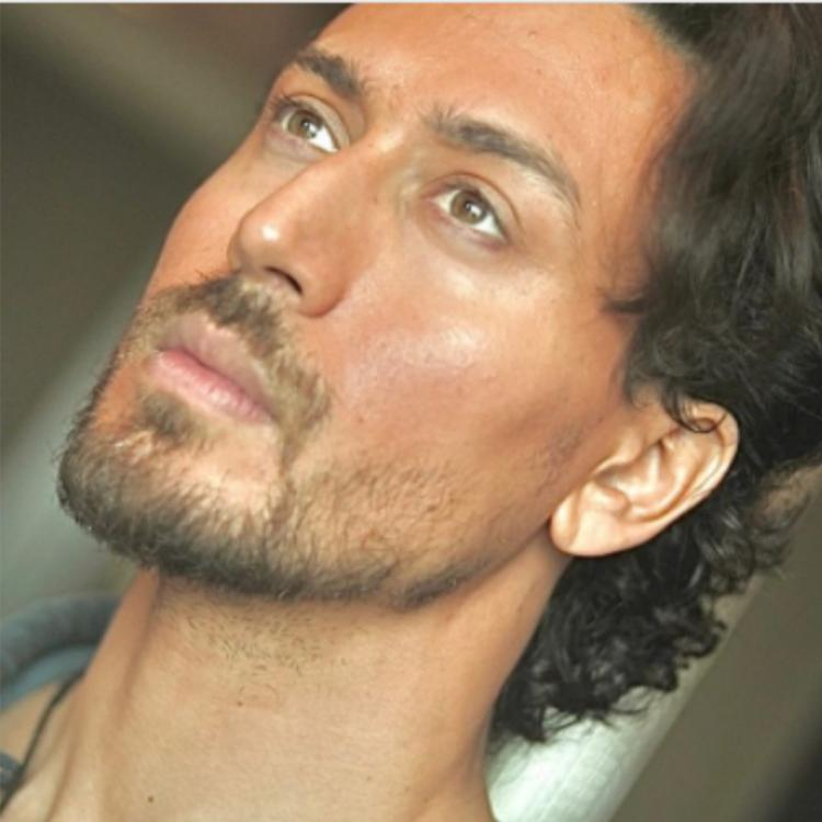 Tiger Shroff draws attention to his chiselled jawline in intense close up shot; Mom Ayesha, Disha Patani react