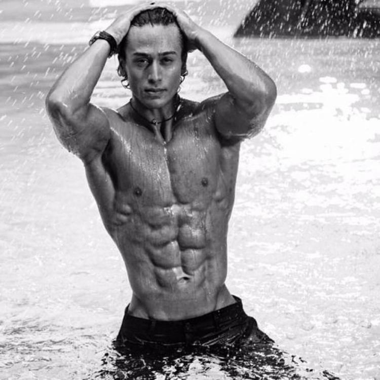 Tiger Shroff flaunts his washboard abs in a shirtless throwback pic from a shoot; Disha Patani loves it