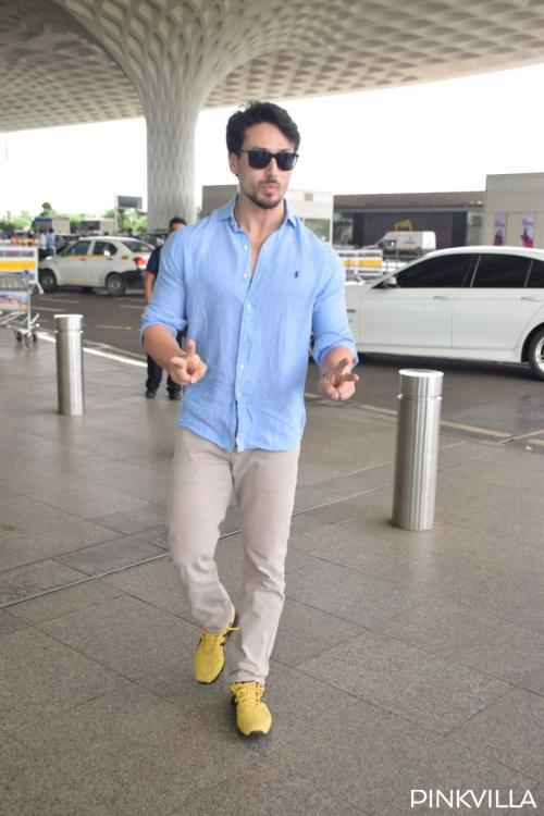 PHOTOS: Tiger Shroff looks dapper as he poses for the paps at the airport; heads to Kolkata for shoot
