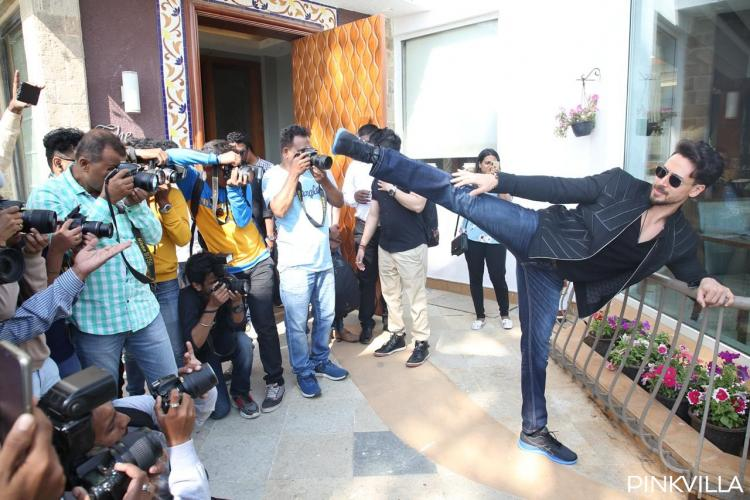 Tiger Shroff performs power kicks as he cuts the cake and celebrates his birthday with the paparazzi