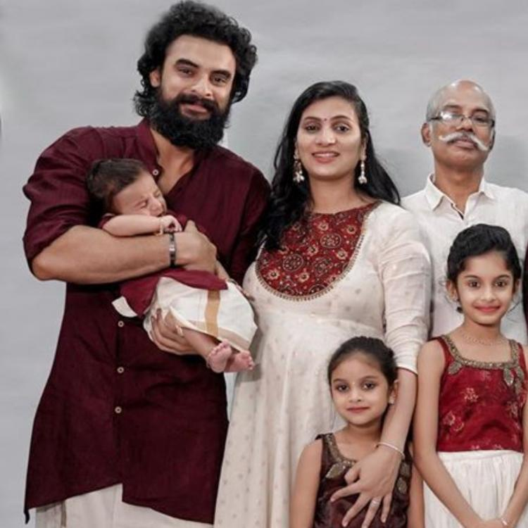 Tovino Thomas shares a beautiful photo with his newborn son and family members as he sends Onam wishes to fans