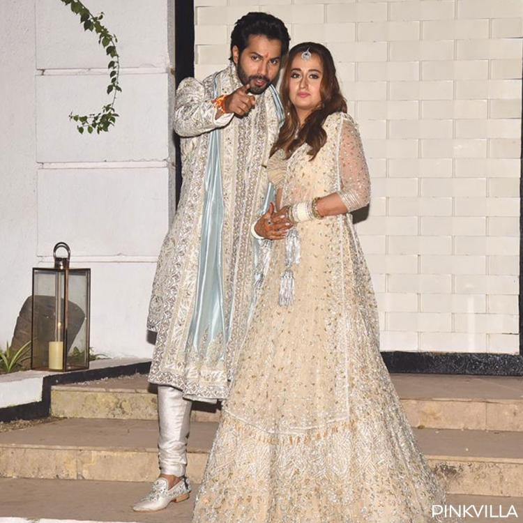 Varun Dhawan asks paps to go easy & not scare his new bride Natasha Dalal as they click newlyweds' pics; WATCH