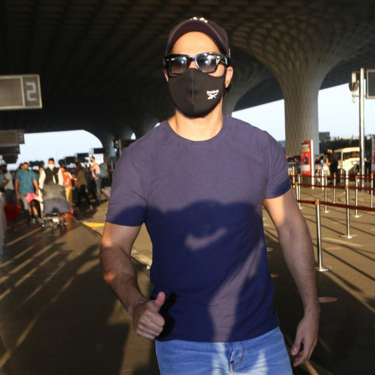 PHOTOS: Varun Dhawan leaves city on early Sunday morning as he gets snapped at the airport.