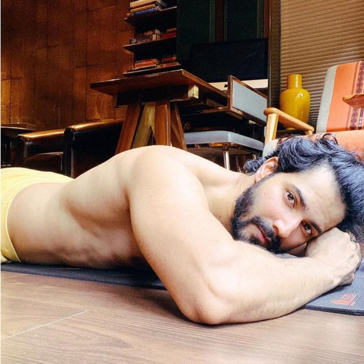 Varun Dhawan goes shirtless & flaunts his toned body; Gives a witty reply when Dino Morea asks who clicked it