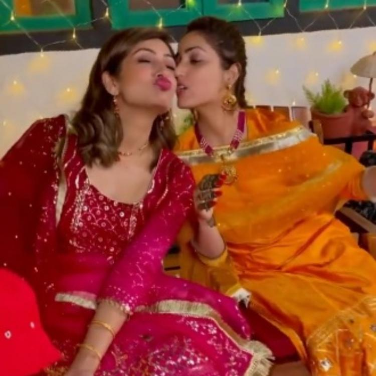 Newlywed Yami Gautam gives a peck on her sister Surilie's cheek in THIS unseen video from Mehendi ceremony