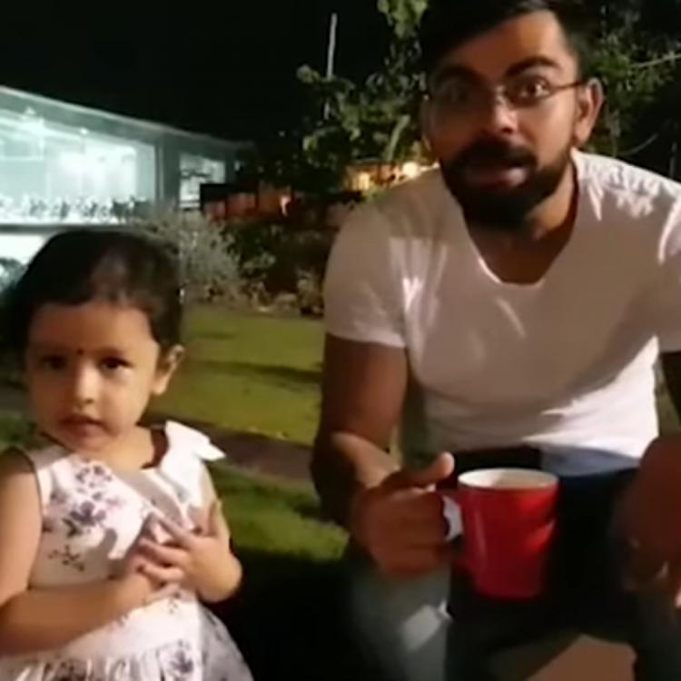 Soon to be dad Virat Kohli playing with Dhoni's daughter Ziva in throwback video.