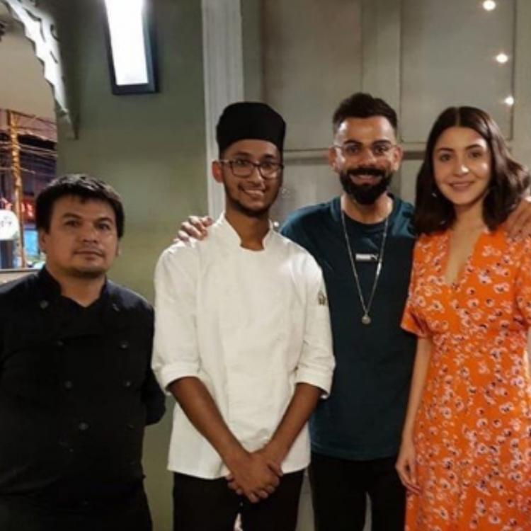 Anushka Sharma and Virat Kohli make for an adorable couple as they pose with the chefs; check it out