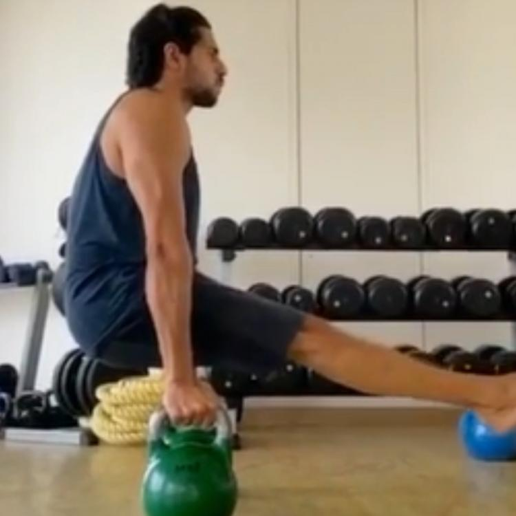 WATCH: Sidharth Malhotra gives us fitspiration for the weekend as he nails the balancing act during workout