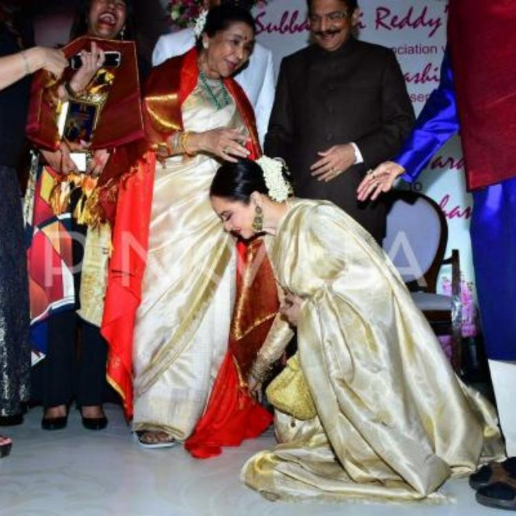 When Rekha made Asha Bhosle emotional after she bowed down to touch the legendary singer's feet