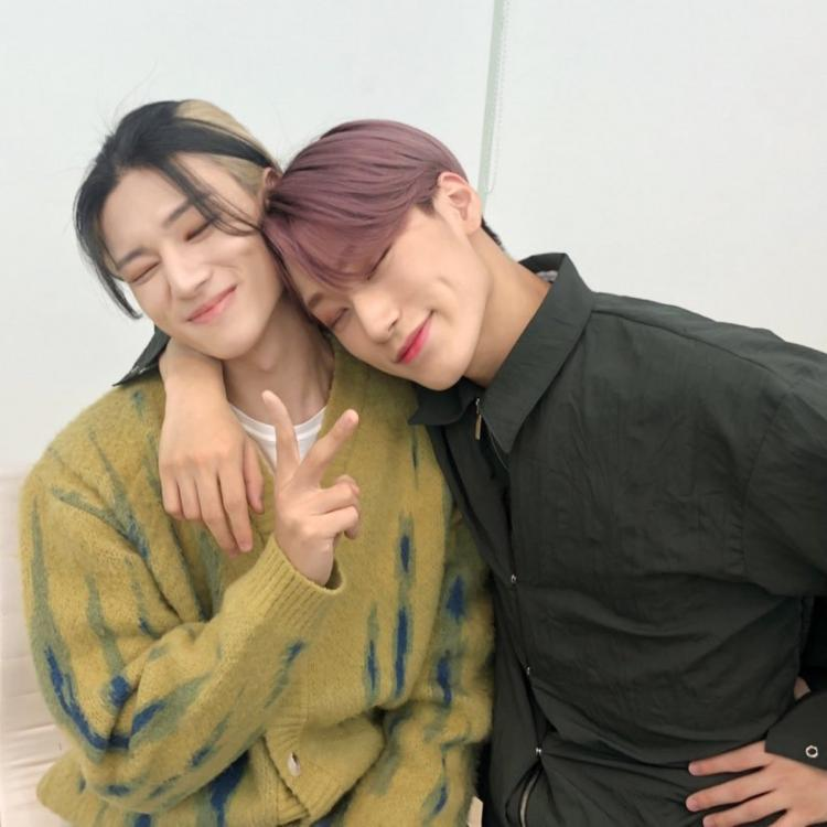 ATEEZ members Wooyoung and San