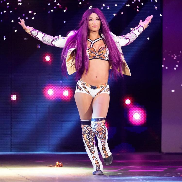 Sasha Banks debuted her blue hair on WWE Raw as she attacked Becky Lynch and Natalya.