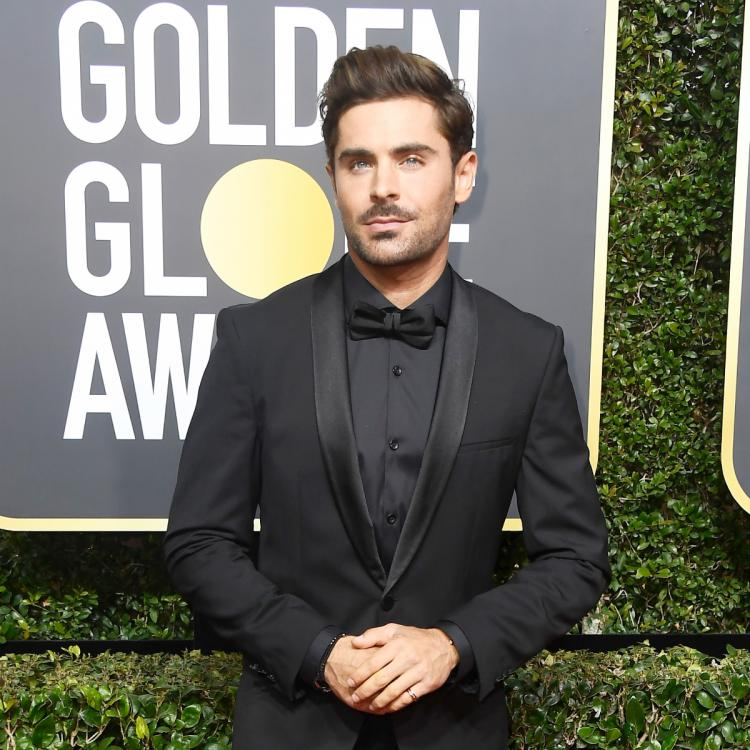 Zac Efron is officially off the market after being spotted holding hands with model Vanessa Valladares