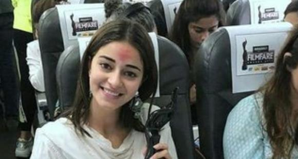 Ananya Panday looks elated holding her Filmfare Award in THESE unseen pics while travelling back to the city