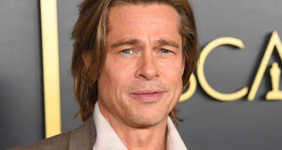 Brad Pitt obliges for a selfie with a fan after his attempt to go unnoticed fails