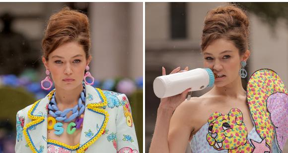 Gigi Hadid walks the runway for Moschino in TWO funky outfits while sucking on a baby bottle