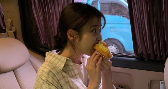 IU munching on a croissant is an adorable sight as OH MY GIRL sends customised food truck to the sets of Dream