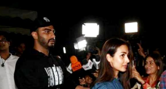 When Arjun Kapoor protected Malaika Arora as they got mobbed after his movie screening; See Photos