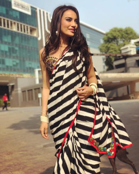 https://www.pinkvilla.com/files/styles/gallery-preview/public/photos_8_times_surbhi_jyoti_proved_she_can_pull_off_a_saree_look_with_sheer_elegance_5.jpg?itok=yoKKV2Az