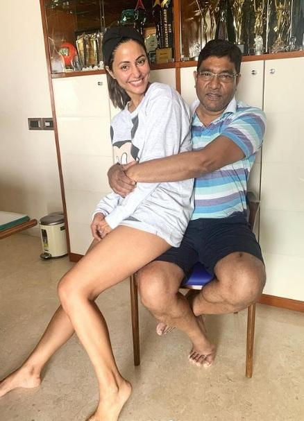 Hina beams with joy while posing with her father