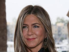 Jennifer Aniston spotted showering hugs and kisses on a mystery man after dinner with friends