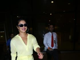 Priyanka Chopra nails an all yellow look as she lands in India but it's her mangalsutra that has our attention