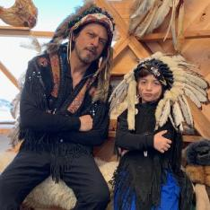 Shah Rukh Khan and his little munchkin AbRam strike a cool pose in the native American war bonnet; see pic