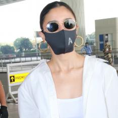 PHOTOS: Alia Bhatt makes a statement in 'A' sequin mask for her airport look as she heads out of Mumbai