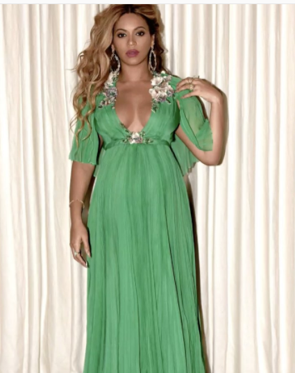 4c02a594bb3 ... herself donning a liquid green Gucci gown — which she wore to the Los  Angeles premiere of Beauty and the Beast — with fluttery cape sleeves.