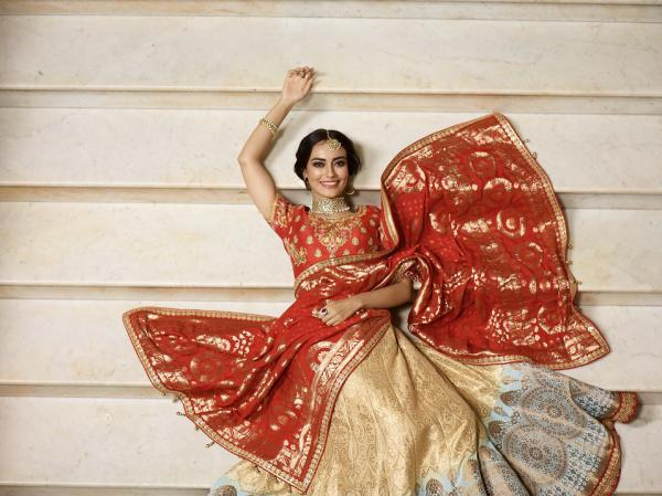 d292cab9251734 Surbhi wore a red and cream lehenga set. The heavily floral embroidered  ensemble looked absolutely stunning on her.