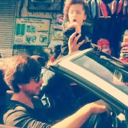 Adorable! AbRam enjoys a fun ride with papa SRK on the busy streets of the city