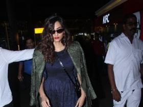 Sonam Kapoor aces her airport look once again as she donnes a blue classy dress with a jacket