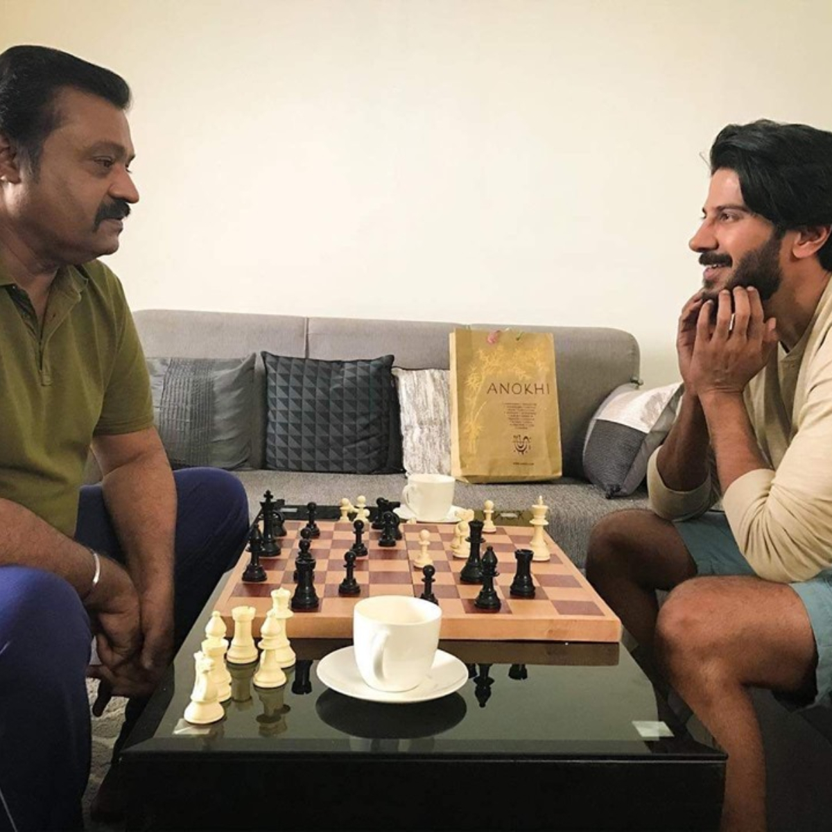 Dulquer Salmaan enjoys a game of chess with actor Suresh Gopi; View Pic