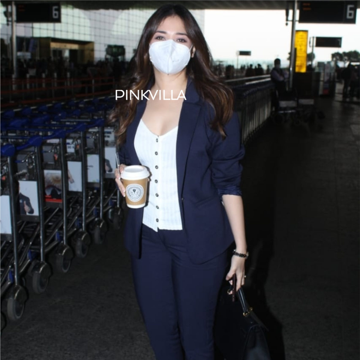 Tamannaah Bhatia keeps her look super formal as she is spotted in the airport; See PHOTOS