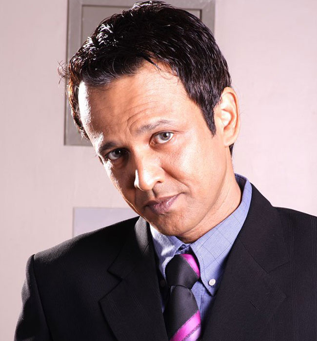 The 50-year old son of father (?) and mother Cashier Menon, 187 cm tall Kay Kay Menon in 2017 photo